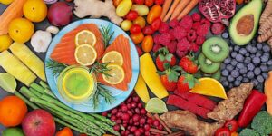 fruits, vegetables, lemon slices, salmon