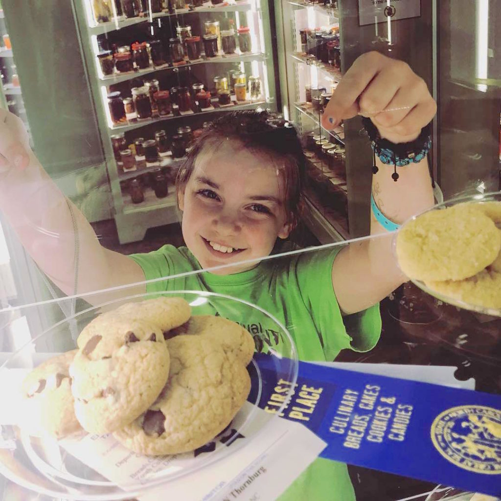 4-H'er poses 1st place with her chocolate chip cookie entry