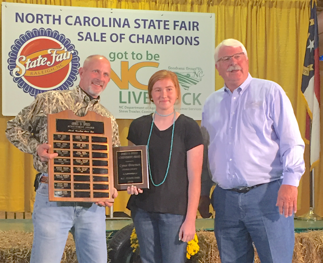 Pictured from left to right: Mark Speed, Senator James D. Speed Achievement Scholarship award winner Lynae Bowman, and Commissioner of Agriculture Steve Troxler