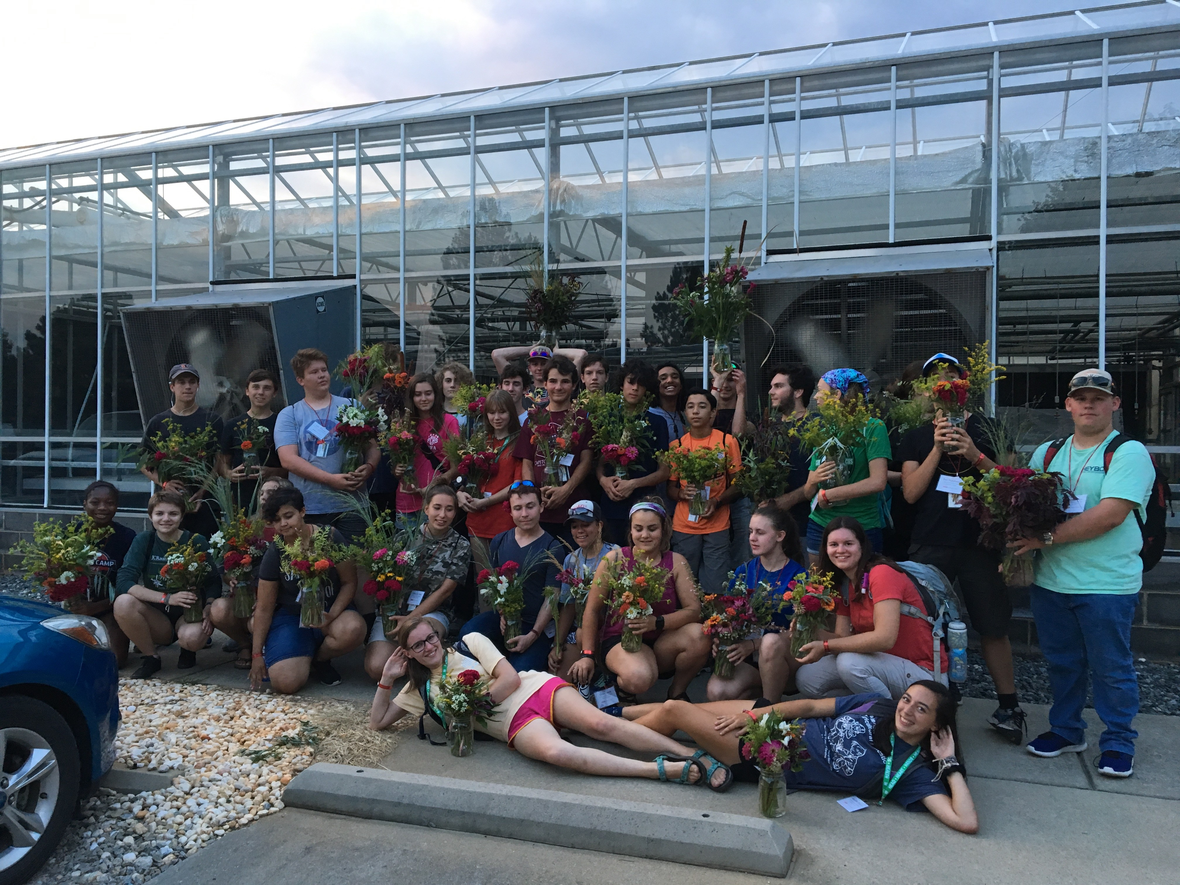 Picture of Horticulture Science Summer Institute students with floral arrangements they made at camp.