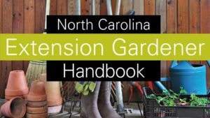 An image of the Extension Gardner's Handbook cover picture of materials used for gardening, including a watering can, rake, broom, garden boots, pots and plants, are collected together.