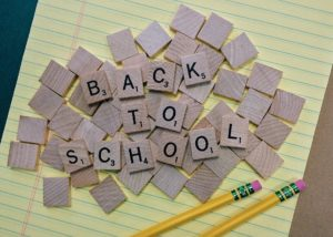 the words back to school, pencils and paper