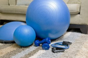 exercise balls and weights in a home setting