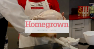 video thumbnail of a cook's apron and hands holding a turkey