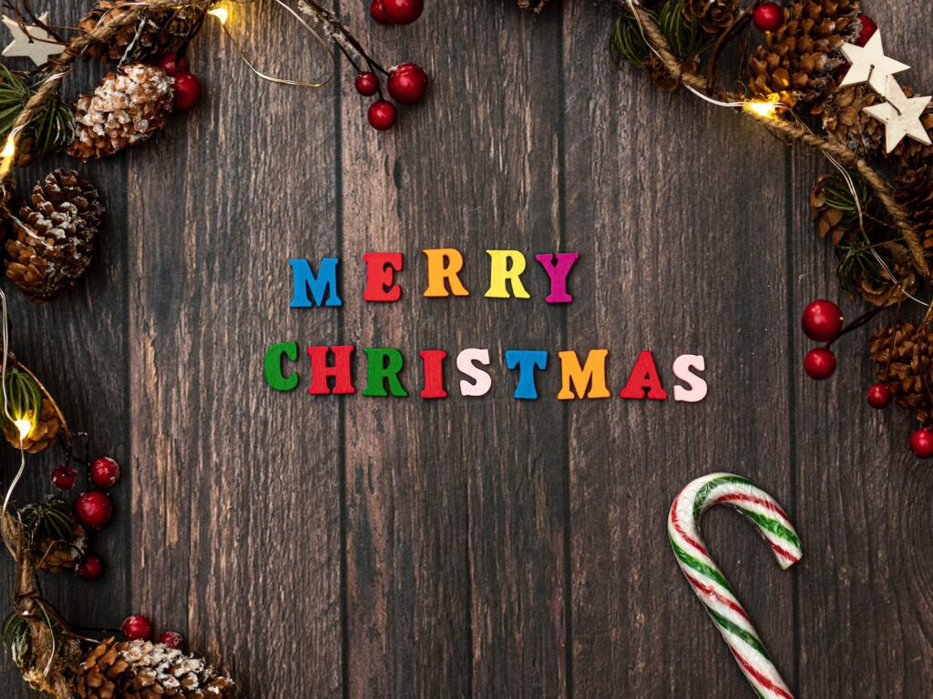 Merry Christmas poster on wood grain background