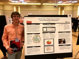 Hall presenting initial Research at 2019 Symposium