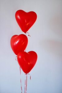 Photo of 3 red heart-shaped balloons by Kristina Paukshtite from Pexels