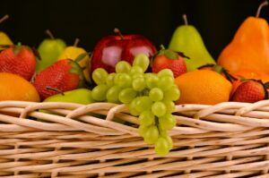 fruit basket - apples, grapes, oranges, pears and strawberries