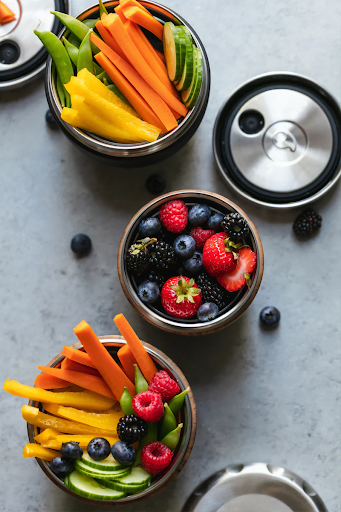 fruits and vegetables in bowls