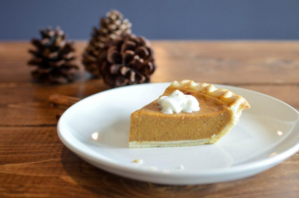 slice of pumpkin pie on white saucer