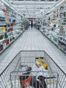 half-full grocery shopping cart in the aisle